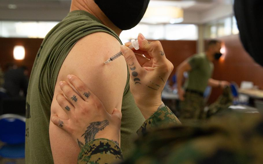 U.S. Marine Corps Sgt. Maj. Curtis A. Rice, sergeant major for 11th Marine Regiment, 1st Marine Division, receives the COVID-19 vaccination on Marine Corps Base Camp Pendleton, Calif., Jan. 15, 2021.