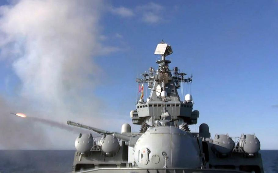 The Russian guided-missile cruiser Varyag and 11 other ships took part in missile-defense drills inside Japan's exclusive economic zone, Monday, Oct. 11, 2021.