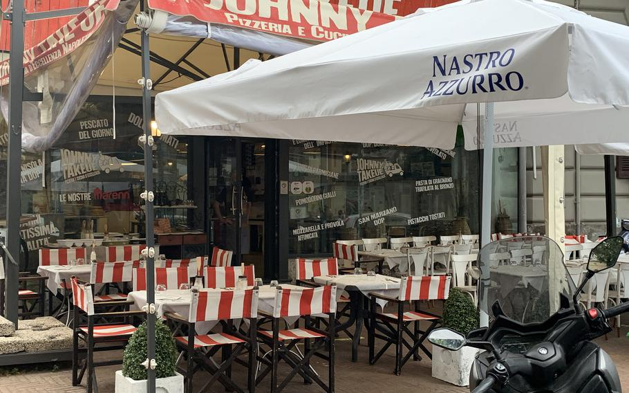 Johnny Take Ue includes outdoor and indoor seating at its Corso Vittorio Emanuele location in Naples' Mergellina neighborhood.