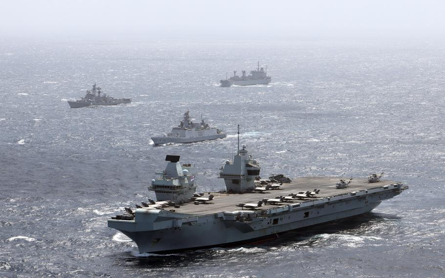 The U.K. Carrier Strike Group, including the aircraft carrier HMS Queen Elizabeth, train with the Indian navy in the Indian Ocean, July 21, 2021.