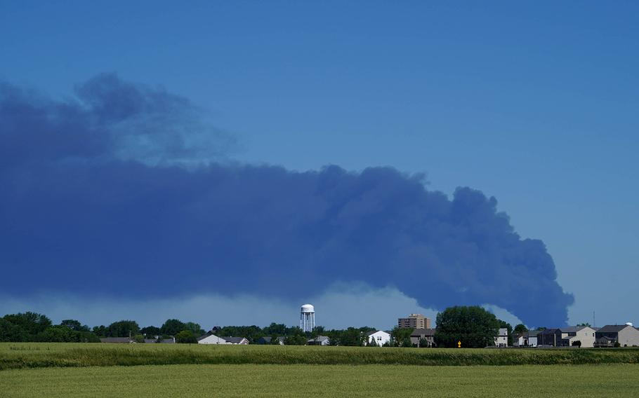 The Chemtool Inc. chemical fire can be seen burning as motorist travel down westbound I-90 on Monday, June 14, 2021, in Belvidere, Illinois.