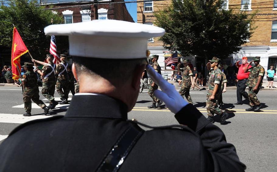 U.S. Marine Chief Warrant Officer 4 Nick D'Andrea salutes the flag during the John Basilone Parade, in Raritan, N.J., Sunday, Sept. 19, 2021