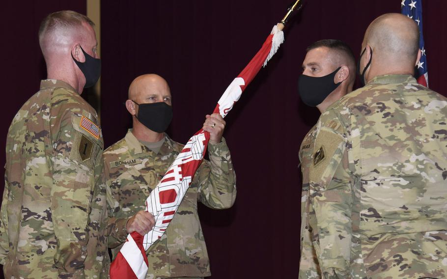 Col. Gary Bonham, holding the guidon, takes command of the Army Corps of Engineers, Japan Engineer District, from Col. Thomas Verell at Camp Zama, Japan, Tuesday, July 20, 2021.