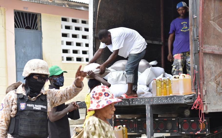 A member of the Haitian National Police guards a World Food Programme food distribution site in Port-Salut.