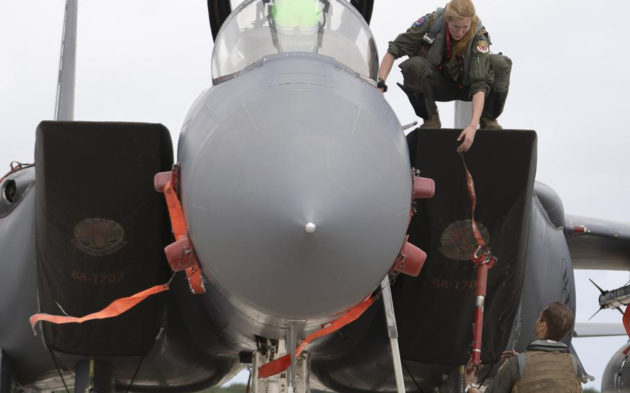 Airmen assigned to the 389th Fighter Squadron inspect an F-15E Strike Eagle after landing at Andersen Air Force Base, Guam, for the Pacific Iron exercise, July 14, 2021.