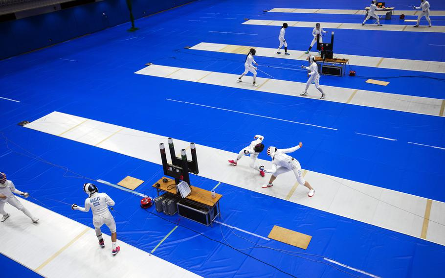 Members of the U.S. women's Olympic fencing team practice inside the Lotus Culture Center Arena, part of the Atago Sports Complex, in Iwakuni, Japan, July 14, 2021.