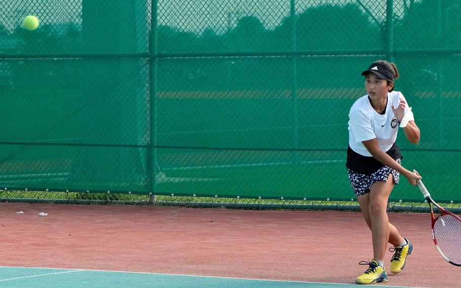 Humphreys' Lizzy Brown sends a forehand shot during Wednesday's DODEA-Korea tennis matches. Brown and her teammate Grace Son beat Osan's Abigail Robertson and Lauren Suh 8-0.