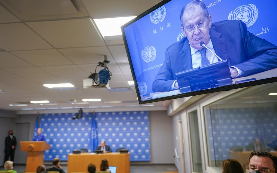 Russian Foreign Minister Sergey Lavrov is seen on a video screen as he speaks to reporters during a news conference during 76th session of the United Nations General Assembly, Saturday, Sept. 25, 2021 at United Nations headquarters.
