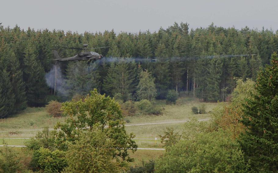 An AH-64D Apache attack helicopter fires during a live-fire aerial gunnery exercise on Grafenwoehr Training Area, Germany, Sept. 21, 2021.