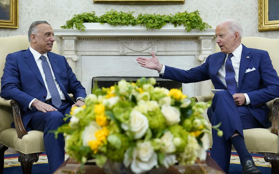 President Joe Biden, right, speaks as Iraqi Prime Minister Mustafa al-Kadhimi, left, listens during their meeting in the Oval Office of the White House in Washington, Monday, July 26, 2021.