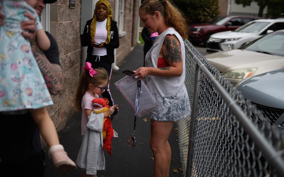 Alessa Morgan, 3, leaves her pre-school program at Begin With Us Pre-K Center in Altoona, Pa.