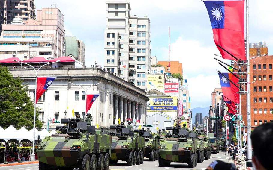 Tanks pass in front of the Presidential Office during the National Day celebration in Taipei, Taiwan, on Oct. 10, 2021.