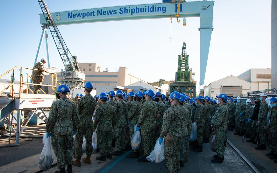 Sailors from USS John C. Stennis finish a foreign object debris walkdown at the Newport News Shipbuilding dry dock where their ship will spend the next four years.