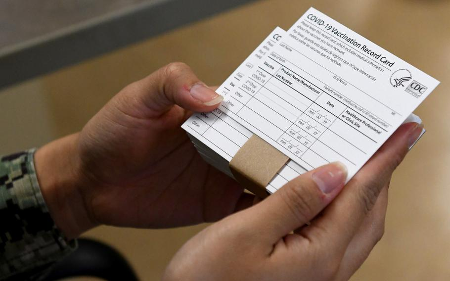 COVID-19 immunization cards are distributed to vaccine recipients following their vaccination.