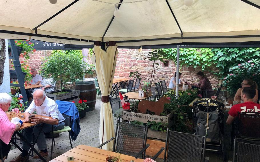 The Swiss House restaurant in Bad Duerkheim, Germany, has a covered outside seating section, where the former garden used to be.