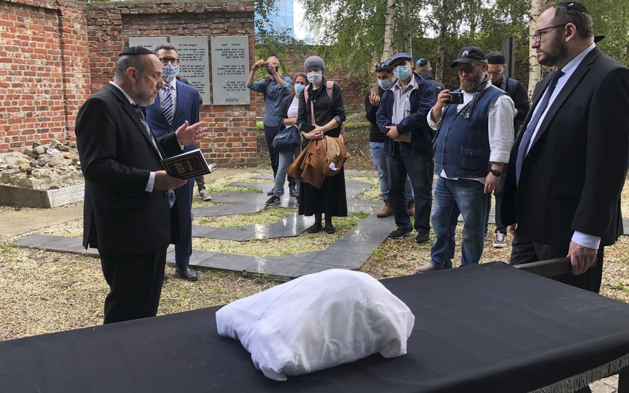 Warsaw's Jewish community held a funeral for an unidentified Holocaust victim after human remains were recently discovered in an area that belonged to the Warsaw Ghetto during World War II, in Warsaw, Poland, Tuesday Sept. 14, 2021.