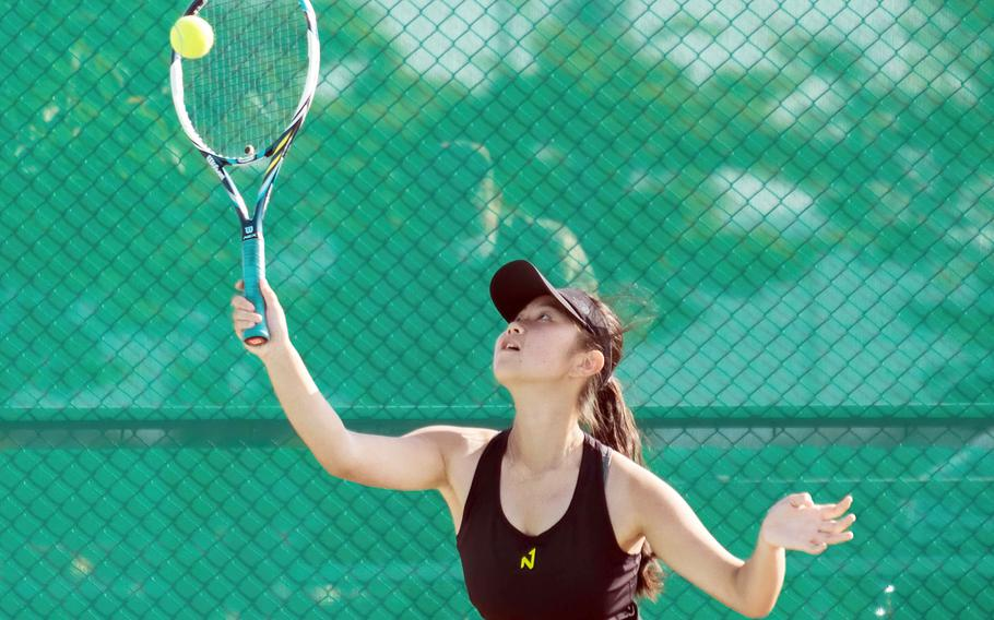 Humphreys' Grace Son hits an overhead shot during Wednesday's DODEA-Korea tennis matches. Son and her teammate Lizzy Brown beat Osan's Abigail Robertson and Lauren Suh 8-0.