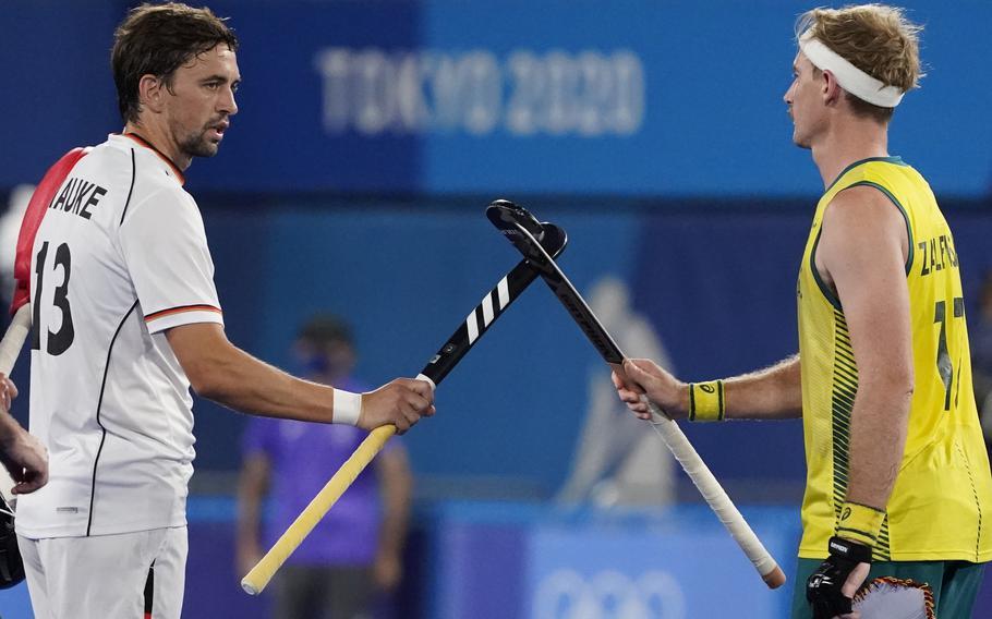 Germany's Tobias Constantin Hauke, left, and Australia's Aran Zalewski (17) greet each other before a men's field hockey semi-final match at the 2020 Summer Olympics Aug. 3 in Tokyo, Japan.