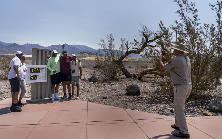 With record-setting heat expected Saturday, tourists such as the Osborne family from Memphis stopped by the thermometer in California's Death Valley National Park.