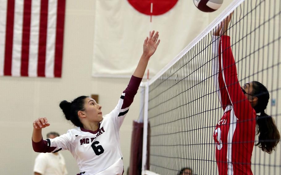 Matthew C. Perry's Chelsea Campbell tries to play the ball past Nile C. Kinnick's Cierra San Nicolas during Saturday's Japan girls volleyball match. The Red Devils won in straight sets.