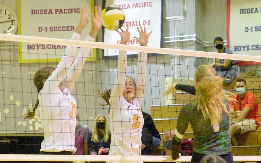 Kubasaki's Emma Leggio drills a spike through the double block of Kadena's Presley Pearce and Morgan Sayers during Thursday's Okinawa volleyball match. The Dragons won in straight sets, improving to 8-0 this season against the Panthers without dropping a set.