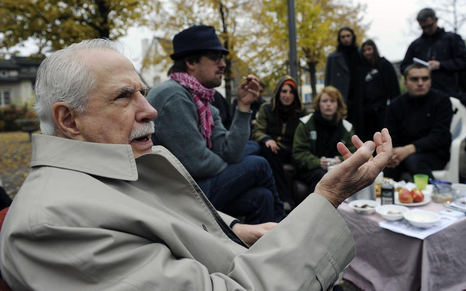 """Former Democratic U.S. senator Mike Gravel gestures while talking to """"Occupy"""" activists at Lindenhof square in Zurich, Switzerland, in this Monday, Oct. 31, 2011, file photo."""
