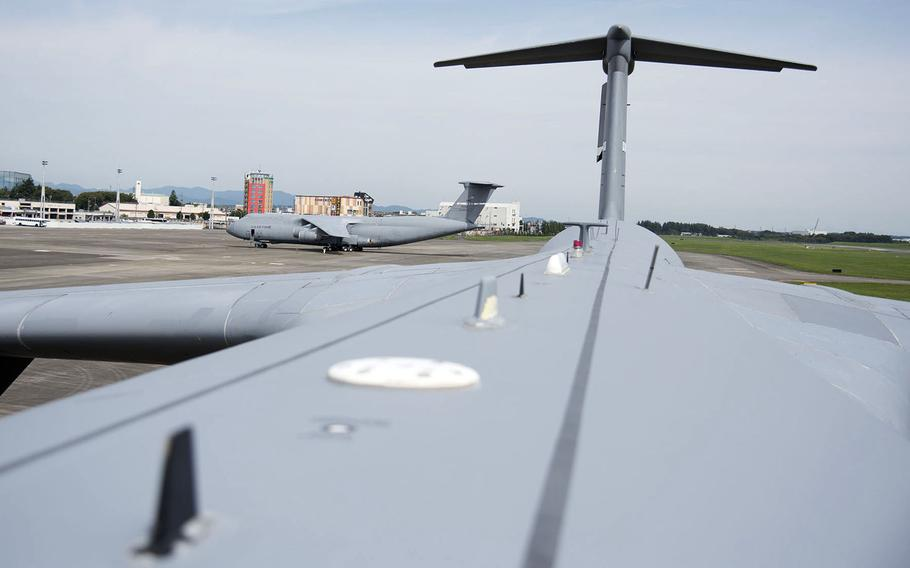 Two C-5M Super Galaxy airlifters park on the flight line at Yokota Air Base, Japan, Sept. 13, 2021.