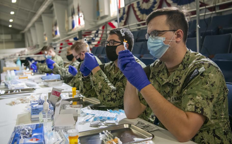 Medical workers at Recruit Training Command in Great Lakes, Ill., prepare doses of COVID-19 vaccine in May 2021. Just over 70% of active-duty U.S. service members were fully vaccinated against COVID-19 as of Sept. 8, 2021.