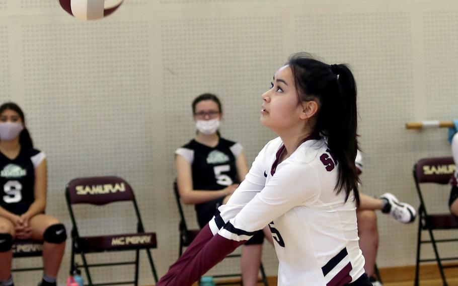 Matthew C. Perry's Haleigh Quinn bumps the ball against Nile C. Kinnick during Saturday's Japan girls volleyball match. The Red Devils won in straight sets.