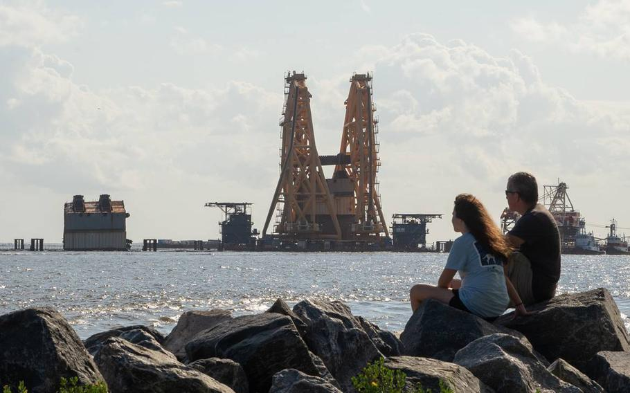 A towering crane straddles remains of the shipwrecked cargo vessel Golden Ray in the waters off St. Simons Island, Ga., on Sunday, Sept. 5, 2021. The South Korean freighter overturned on Sept. 8, 2019, shortly after leaving the Port of Brunswick.