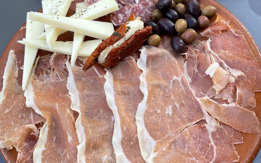 The large cold plate at Egon's La Bodega in Weiden, Germany. It consists of ham, cheese and olives.