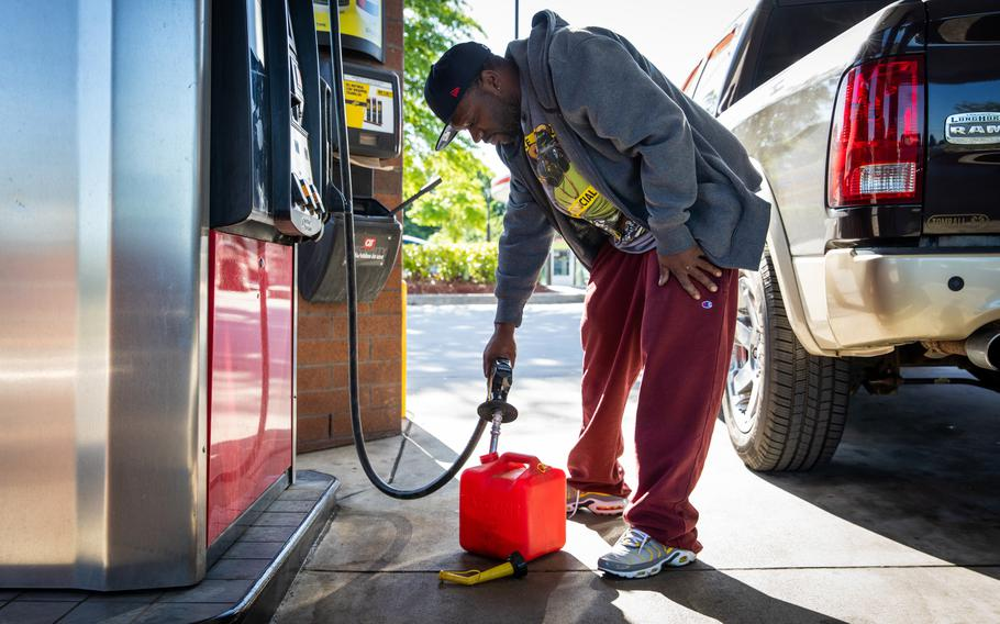 Jerald White fills a gas container at a station in Morrow, Ga., on May 13, 2021, as demand for gasoline surged following a cyberattack on Colonial Pipeline.