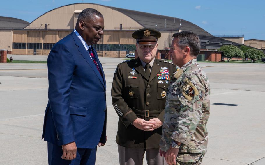 Defense Secretary Lloyd Austin and Army Gen. Mark Milley, chairman of the Joint Chiefs of Staff, greet Army Gen. Austin Miller as he returns to the U.S. from Afghanistan at Joint Base Andrews, Md., on July 14, 2021.