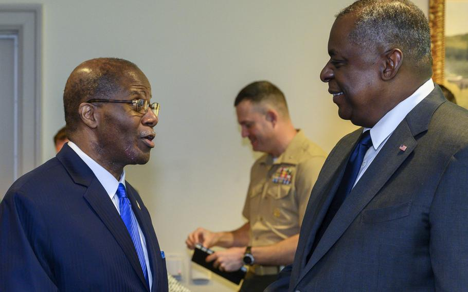 Secretary of Defense Lloyd J. Austin III speaks with Under Secretary of Defense for Intelligence and Security Ronald Moultrie at the Pentagon in Washington on June 1, 2021. Moultrie testified in a House hearing on Capitol Hill on Friday, June 11, that DOD intelligence agencies are overhauling efforts to combat foreign influence and disinformation campaigns.