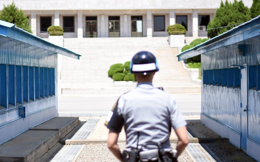 North and South Korean soldiers face off at the Joint Security inside the Demilitarized Zone, May 24, 2017.