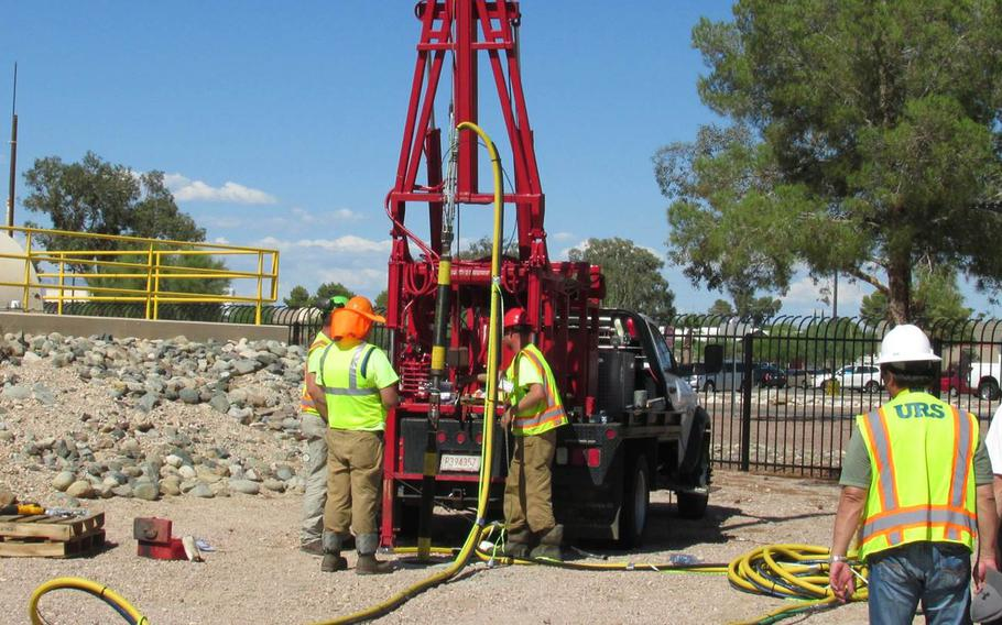 An environmental restoration crew lowers an injection tool into a well as part of the environmental hydrofracturing process. The technology creates small underground cracks into which a slurry of sand, soy beans, laundry detergent, nutrients and micro-organisms will be injected to accelerate removal of contamination previously trapped in dense soils around Air Force Plant 44 in Tucson, Arizona.