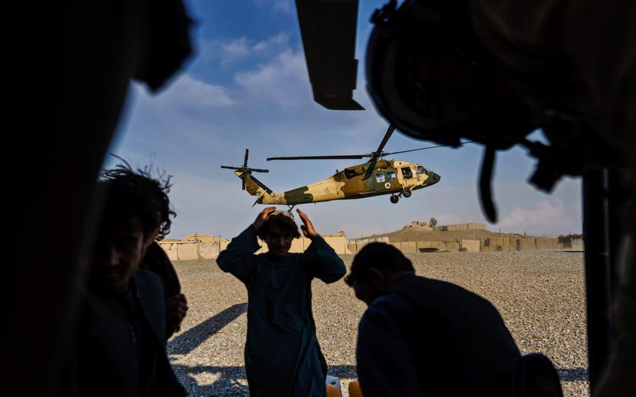 During a resupply mission, a second UH-60 Blackhawk arrives an outpost in the Shah Wali Kot district north of Kandahar, Afghanistan.