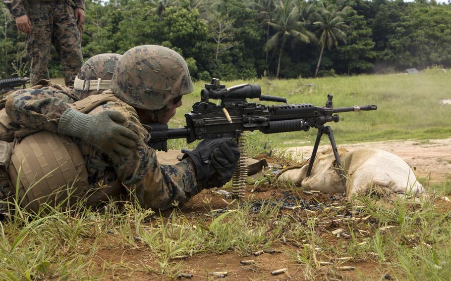 A Marine fires an M249 light machine gun during training at Andersen Air Force Base, Guam, Sept. 1, 2017.