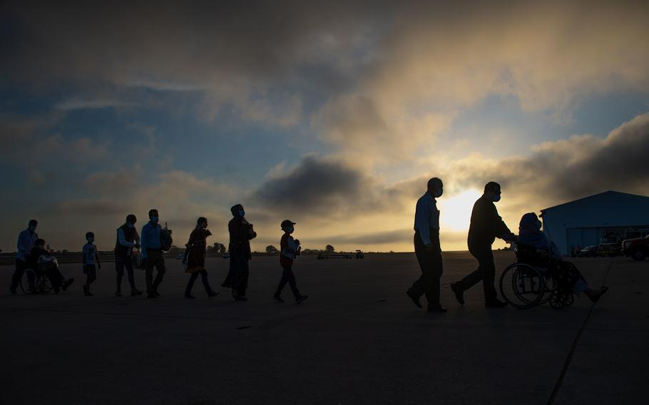 Evacuees from Afghanistan depart a U.S. Air Force KC-10 Extender after landing at Naval Station Rota, Spain, Aug. 31, 2021.