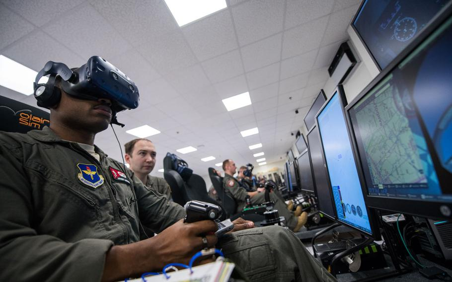 """Detachment 24 student pilots train on a virtual reality flight simulator as part of the Pilot Training Next program March 5, 2020, at Joint Base San Antonio-Randolph, Texas. The program is part of Air Education and Training Command's initiative to """"reimagine"""" how learning is delivered to airmen."""