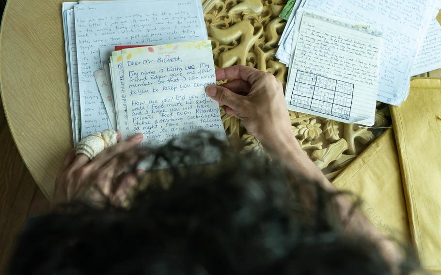 Samuel Bickett reads the letters he received during his detaining time in jail on Aug. 16, 2021 in Hong Kong.