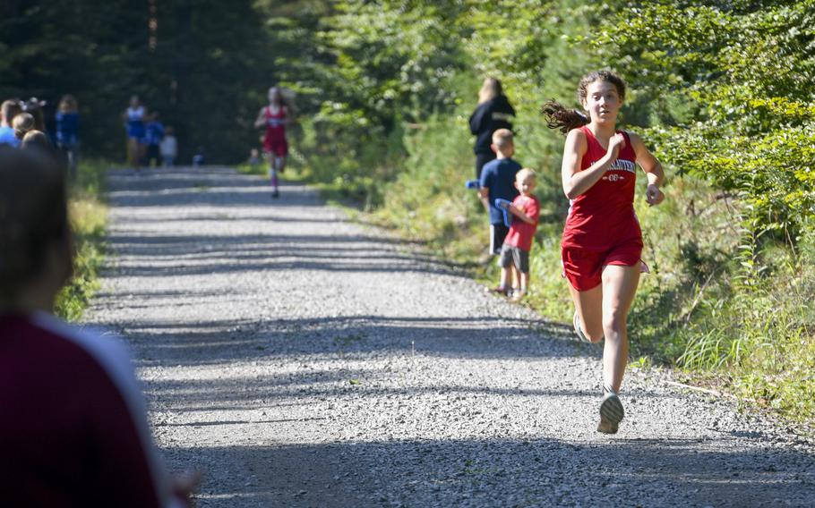 Piper Parsells, 16, a junior at Kaiserslautern, races to the finish line at a high school girls' varsity cross country meet Saturday, Sept. 18, 2021, in Kaiserslautern, Germany.