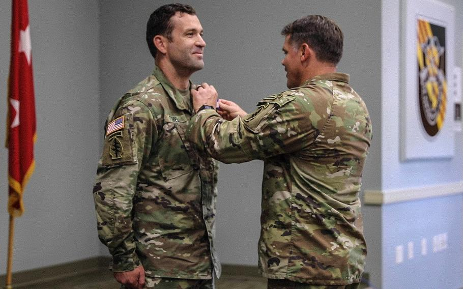 Sgt. Ian Tyrrel receives the Soldier's Medal for heroism, July 14, 2021, at Fort Campbell, Ky. Tyrrel was awarded the medal for saving an injured woman from drowning, on what was supposed to be a relaxing kayak trip on Tennessee's Red River.