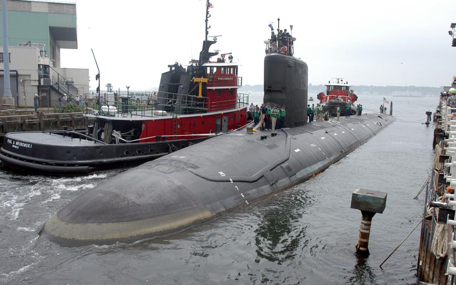 The USS Virginia returns to the Electric Boat Shipyard in Groton Conn., after its first sea trials in July 2004. A Navy nuclear engineer and his wife have been charged with repeatedly trying to pass along secrets on the design, operations and performance of Virginia-class nuclear submarine reactors, according to court documents.