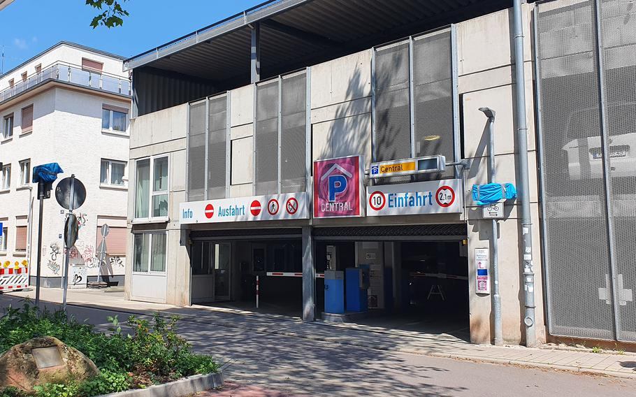 German police on July 22, 2021, released security camera footage from December of a man pulling a shopping cart with a large object wrapped in white past this downtown Kaiserslautern parking garage on Rosenstrasse.The man is a suspect in the killing of Diana Bodi, who was found dead in an alley near the garage, in December last year.