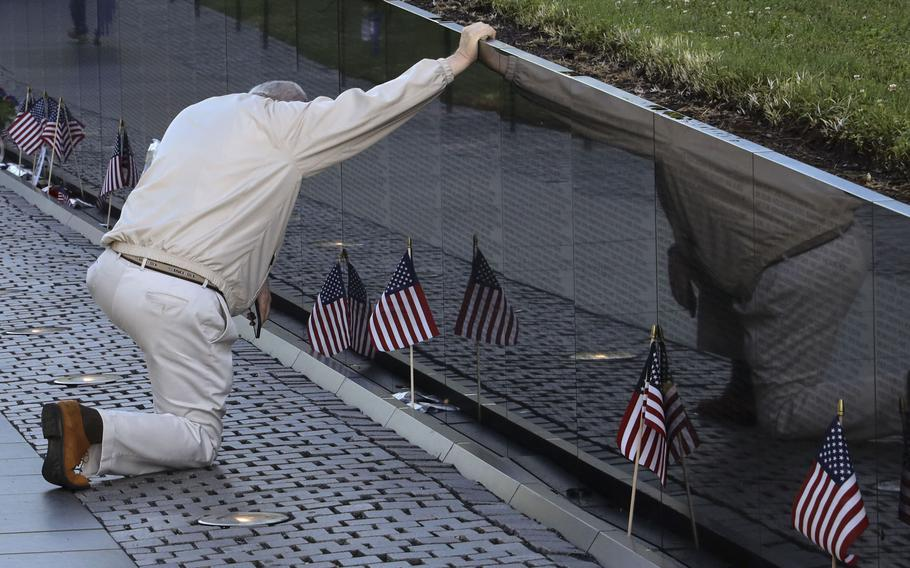 A visitor to the Vietnam Veterans Memorial in Washington, D.C., pays his respects on Memorial Day, May 31, 2021.