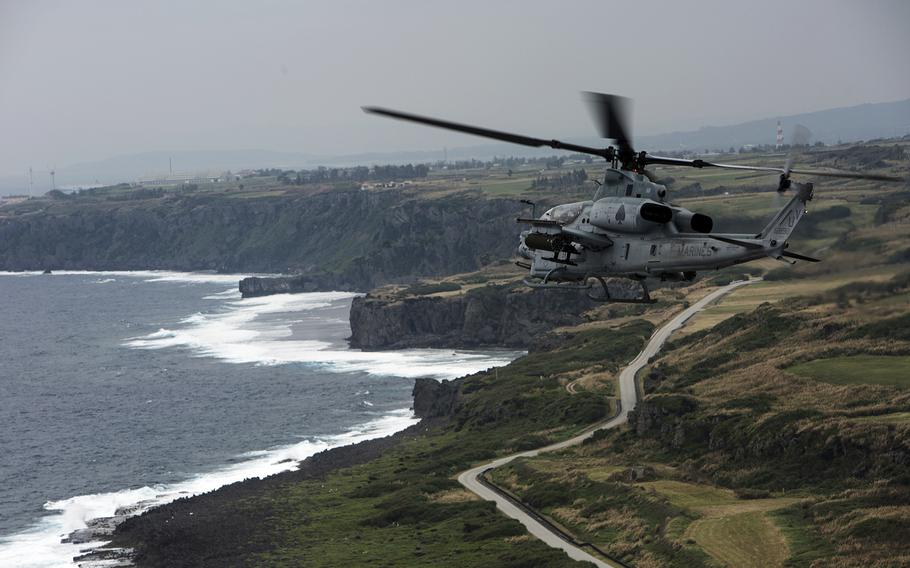 An AH-1Z Viper from Marine Light Attack Helicopter Squadron 267 flies toward an arming and refueling point on Ie Shima, Okinawa, Jan. 10, 2017.