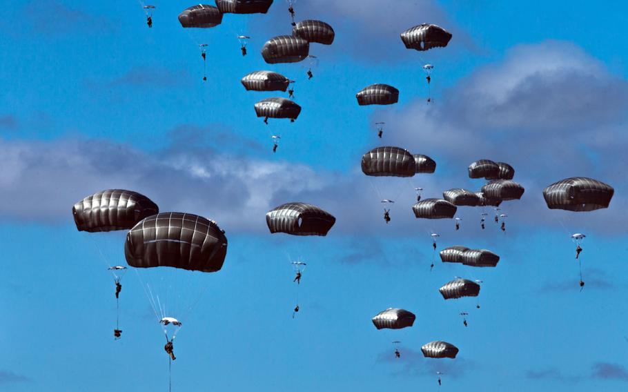 U.S. Army paratroopers jump onto a drop zone during the Talisman Sabre exercise in Queensland, Australia, Wednesday, July 28, 2021.