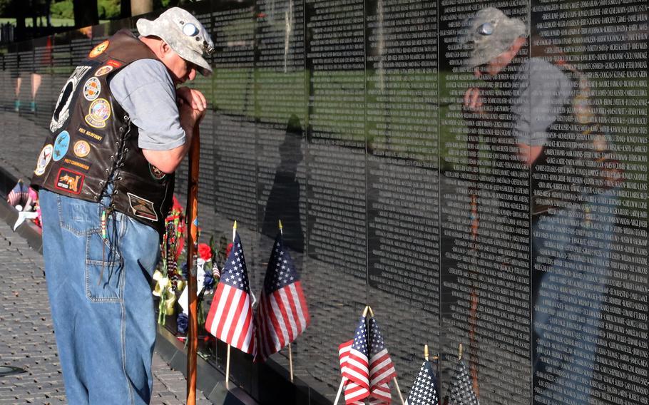 Army veteran Bernie Klomanek of Mineral, Va. remembers the fallen during a Memorial Day visit to the Vietnam Veterans Memorial in Washington, D.C., May 31, 2021.