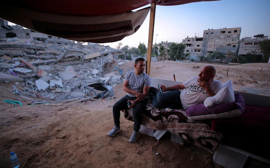 Kayan Abu Safiya, right, and his son Yazid, rest outside their destroyed home in Beit Lahia.